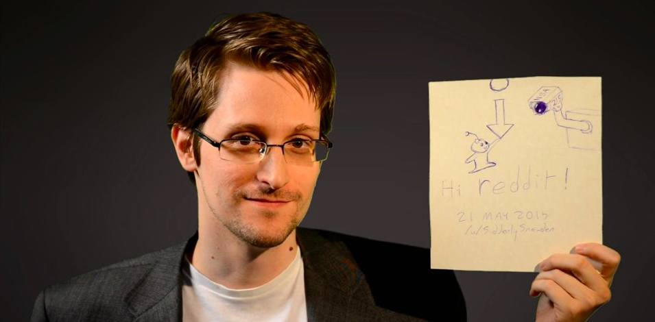 Photo of Edward Snowden holding paper